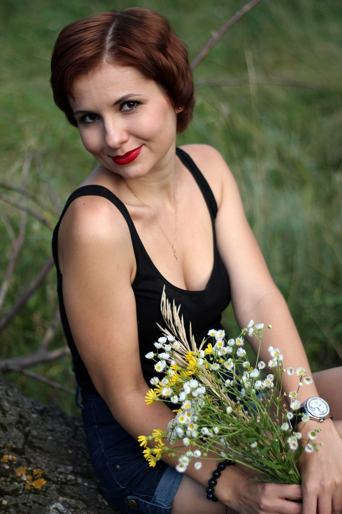 Russian woman with flowers eager for dating
