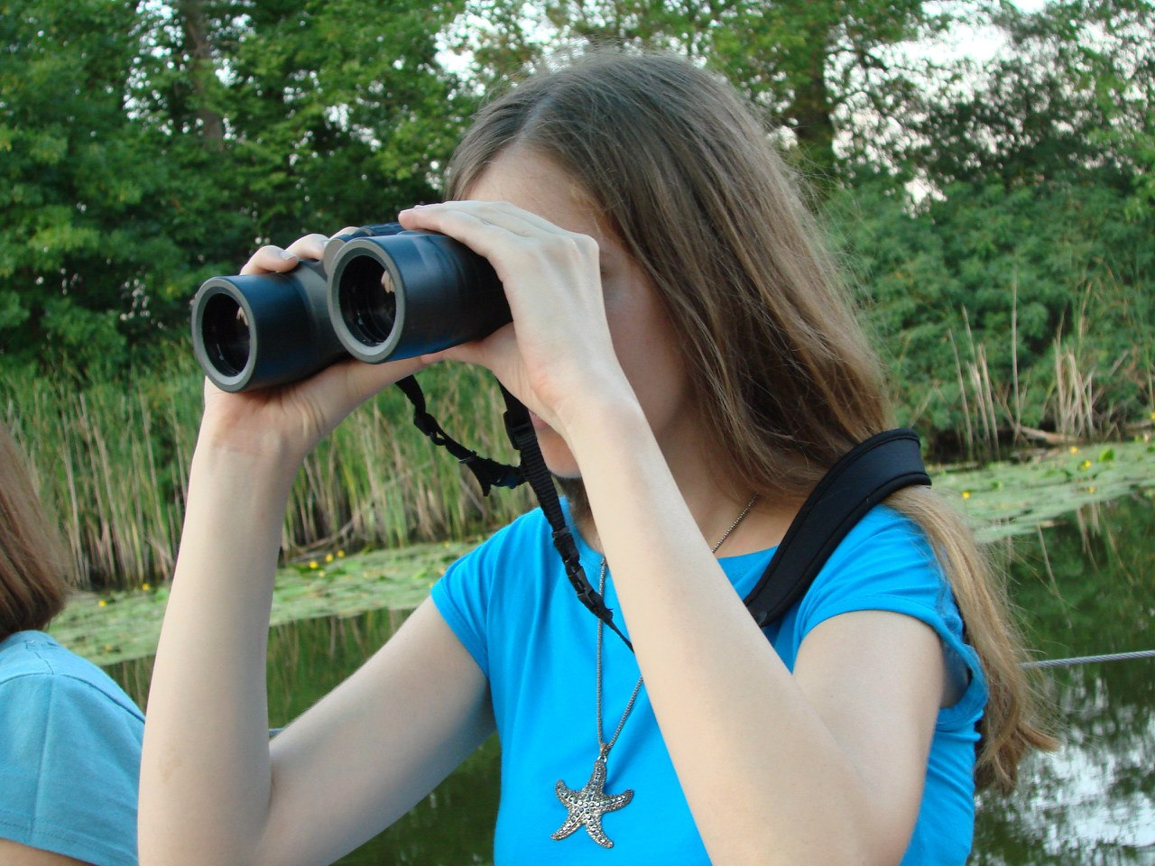 Russian woman using binoculars
